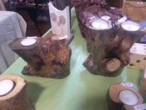 κηροπήγεια ξύλο ελιάς διακοσμητικά και διάφορα χειροποίητα είδη - decorative and various handmade crafts - handicraftcyprus.com - όλα τα είδη χειροτεχνημάτων του εργαστηρίου μας. χειροποίητα δώρα, τάβλια με σκάλισμα και πυρογραφία, σκάκια σκαλιστά, ξύλινα ρολόγια με σκάλισμα, παιδικά κρεμμασταράκια με παιδικούς ήρωες, ξύλινες φιγούρες και σχήματα, σχέδιο με πυρογράφο σε νεροκολοκύθες, μπομπονιέρες βάφτισης, μπομπονιέρες γάμου γάμων, επιχειρηματικά δώρα, ξεχωριστά δώρα επιχειρήσεων, παλαίωση φωτογραφίας, μπαούλα σκαλιστά, κρεμμασταράκια τοίχου για κλειδιά, κρεμμαστάρια ρούχων σκαλιστά, σκαλιστές κορνίζες, χειροποίητοι καθρέφτες με σκάλισμα, εικόνες αγίων με σκάλισμα, παλαιωμένες εικόνες αγίων, διακοσμητικά είδη χειροποίητα, αξεσουάρ γραφείου, σχέδια σε ξύλο, ξυλογλυπτική, παλαίωση εικόνων, αγιογραφίες, πυρογραφία, χαλκογραφία, κορνίζες, καθρέφτες, χειροποίητα, βάφτιση, γάμος, επέτειος, Πάφος, Λευκωσία, Λεμεσός, Λάρνακα.