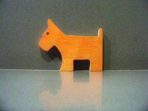 σκυλάκι φιγούρα - χειροποίητες μπομπονιέρες - handmade bonbonniere - handicraftcyprus.com - όλα τα είδη χειροτεχνημάτων του εργαστηρίου μας. χειροποίητα δώρα, τάβλια με σκάλισμα και πυρογραφία, σκάκια σκαλιστά, ξύλινα ρολόγια με σκάλισμα, παιδικά κρεμμασταράκια με παιδικούς ήρωες, ξύλινες φιγούρες και σχήματα, σχέδιο με πυρογράφο σε νεροκολοκύθες, μπομπονιέρες βάφτισης, μπομπονιέρες γάμου γάμων, επιχειρηματικά δώρα, ξεχωριστά δώρα επιχειρήσεων, παλαίωση φωτογραφίας, μπαούλα σκαλιστά, κρεμμασταράκια τοίχου για κλειδιά, κρεμμαστάρια ρούχων σκαλιστά, σκαλιστές κορνίζες, χειροποίητοι καθρέφτες με σκάλισμα, εικόνες αγίων με σκάλισμα, παλαιωμένες εικόνες αγίων, διακοσμητικά είδη χειροποίητα, αξεσουάρ γραφείου, σχέδια σε ξύλο, ξυλογλυπτική, παλαίωση εικόνων, αγιογραφίες, πυρογραφία, χαλκογραφία, κορνίζες, καθρέφτες, χειροποίητα, βάφτιση, γάμος, επέτειος, Πάφος, Λευκωσία, Λεμεσός, Λάρνακα.