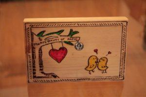 αγάπη σχέδιο με πυρογραφία - ξύλινες φιγούρες και σχέδια - handicraftcyprus.com - όλα τα είδη χειροτεχνημάτων του εργαστηρίου μας. χειροποίητα δώρα, τάβλια με σκάλισμα και πυρογραφία, σκάκια σκαλιστά, ξύλινα ρολόγια με σκάλισμα, παιδικά κρεμμασταράκια με παιδικούς ήρωες, ξύλινες φιγούρες και σχήματα, σχέδιο με πυρογράφο σε νεροκολοκύθες, μπομπονιέρες βάφτισης, μπομπονιέρες γάμου γάμων, επιχειρηματικά δώρα, ξεχωριστά δώρα επιχειρήσεων, παλαίωση φωτογραφίας, μπαούλα σκαλιστά, κρεμμασταράκια τοίχου για κλειδιά, κρεμμαστάρια ρούχων σκαλιστά, σκαλιστές κορνίζες, χειροποίητοι καθρέφτες με σκάλισμα, εικόνες αγίων με σκάλισμα, παλαιωμένες εικόνες αγίων, διακοσμητικά είδη χειροποίητα, αξεσουάρ γραφείου, σχέδια σε ξύλο, ξυλογλυπτική, παλαίωση εικόνων, αγιογραφίες, πυρογραφία, χαλκογραφία, κορνίζες, καθρέφτες, χειροποίητα, βάφτιση, γάμος, επέτειος, Πάφος, Λευκωσία, Λεμεσός, Λάρνακα.
