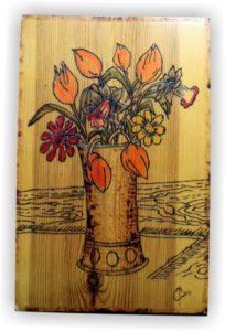 βάζο λουλούδια σχέδιο με πυρογραφία - ξύλινες φιγούρες και σχέδια - handicraftcyprus.com - όλα τα είδη χειροτεχνημάτων του εργαστηρίου μας. χειροποίητα δώρα, τάβλια με σκάλισμα και πυρογραφία, σκάκια σκαλιστά, ξύλινα ρολόγια με σκάλισμα, παιδικά κρεμμασταράκια με παιδικούς ήρωες, ξύλινες φιγούρες και σχήματα, σχέδιο με πυρογράφο σε νεροκολοκύθες, μπομπονιέρες βάφτισης, μπομπονιέρες γάμου γάμων, επιχειρηματικά δώρα, ξεχωριστά δώρα επιχειρήσεων, παλαίωση φωτογραφίας, μπαούλα σκαλιστά, κρεμμασταράκια τοίχου για κλειδιά, κρεμμαστάρια ρούχων σκαλιστά, σκαλιστές κορνίζες, χειροποίητοι καθρέφτες με σκάλισμα, εικόνες αγίων με σκάλισμα, παλαιωμένες εικόνες αγίων, διακοσμητικά είδη χειροποίητα, αξεσουάρ γραφείου, σχέδια σε ξύλο, ξυλογλυπτική, παλαίωση εικόνων, αγιογραφίες, πυρογραφία, χαλκογραφία, κορνίζες, καθρέφτες, χειροποίητα, βάφτιση, γάμος, επέτειος, Πάφος, Λευκωσία, Λεμεσός, Λάρνακα.