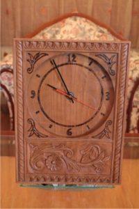 ξύλινο ρολόι τοίχου σκαλιστό με πυρογραφία - handicraftcyprus.com - όλα τα είδη χειροτεχνημάτων του εργαστηρίου μας. χειροποίητα δώρα, τάβλια με σκάλισμα και πυρογραφία, σκάκια σκαλιστά, ξύλινα ρολόγια με σκάλισμα, παιδικά κρεμμασταράκια με παιδικούς ήρωες, ξύλινες φιγούρες και σχήματα, σχέδιο με πυρογράφο σε νεροκολοκύθες, μπομπονιέρες βάφτισης, μπομπονιέρες γάμου γάμων, επιχειρηματικά δώρα, ξεχωριστά δώρα επιχειρήσεων, παλαίωση φωτογραφίας, μπαούλα σκαλιστά, κρεμμασταράκια τοίχου για κλειδιά, κρεμμαστάρια ρούχων σκαλιστά, σκαλιστές κορνίζες, χειροποίητοι καθρέφτες με σκάλισμα, εικόνες αγίων με σκάλισμα, παλαιωμένες εικόνες αγίων, διακοσμητικά είδη χειροποίητα, αξεσουάρ γραφείου, σχέδια σε ξύλο, ξυλογλυπτική, παλαίωση εικόνων, αγιογραφίες, πυρογραφία, χαλκογραφία, κορνίζες, καθρέφτες, χειροποίητα, βάφτιση, γάμος, επέτειος, Πάφος, Λευκωσία, Λεμεσός, Λάρνακα.
