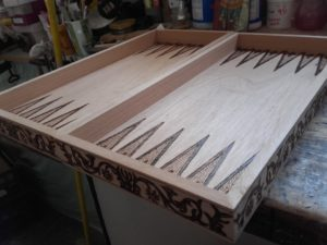 χειροποίητο τάβλι με πυρογραφία - handmade backgammon boards with pyrography - handicraftcyprus.com - όλα τα είδη χειροτεχνημάτων του εργαστηρίου μας. χειροποίητα δώρα, τάβλια με σκάλισμα και πυρογραφία, σκάκια σκαλιστά, ξύλινα ρολόγια με σκάλισμα, παιδικά κρεμμασταράκια με παιδικούς ήρωες, ξύλινες φιγούρες και σχήματα, σχέδιο με πυρογράφο σε νεροκολοκύθες, μπομπονιέρες βάφτισης, μπομπονιέρες γάμου γάμων, επιχειρηματικά δώρα, ξεχωριστά δώρα επιχειρήσεων, παλαίωση φωτογραφίας, μπαούλα σκαλιστά, κρεμμασταράκια τοίχου για κλειδιά, κρεμμαστάρια ρούχων σκαλιστά, σκαλιστές κορνίζες, χειροποίητοι καθρέφτες με σκάλισμα, εικόνες αγίων με σκάλισμα, παλαιωμένες εικόνες αγίων, διακοσμητικά είδη χειροποίητα, αξεσουάρ γραφείου, σχέδια σε ξύλο, ξυλογλυπτική, παλαίωση εικόνων, αγιογραφίες, πυρογραφία, χαλκογραφία, κορνίζες, καθρέφτες, χειροποίητα, βάφτιση, γάμος, επέτειος, Πάφος, Λευκωσία, Λεμεσός, Λάρνακα.